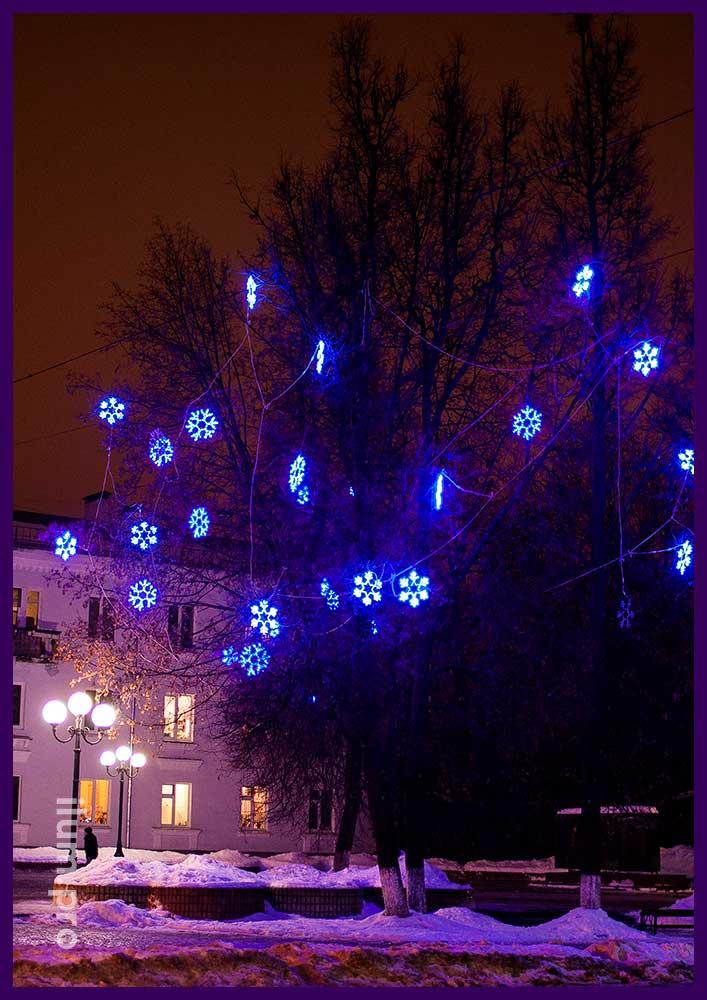 Световые снежинки для украшения деревьев