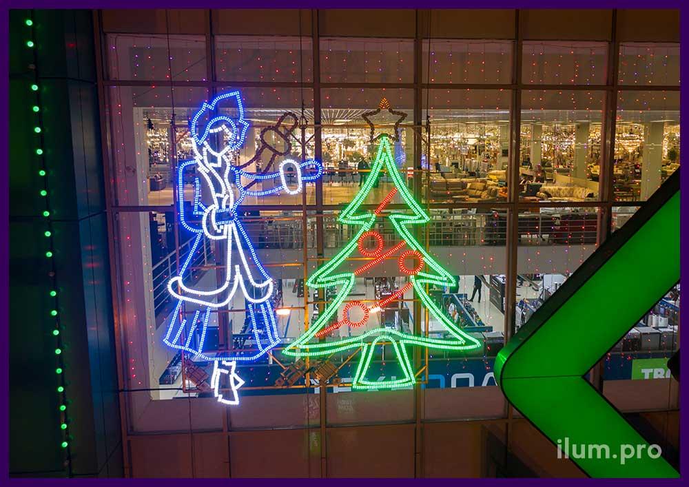 Украшение фасада ТЦ на Новый год световыми фигурами