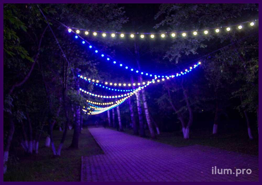 Дорожка из гирлянд белтлайт на тросах в парке села Орда