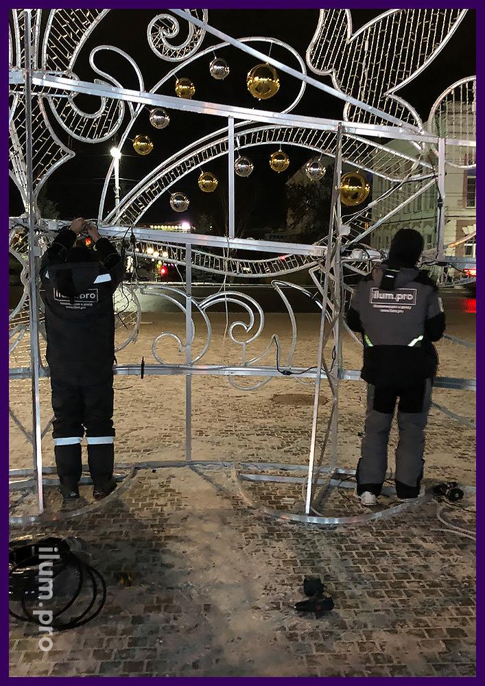 Крепление каркаса новогодней иллюминации к тротуарной плитке на анкерное соединение