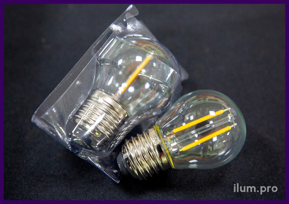 Лампочка филаментная с прозрачной колбой и тёпло-белым свечением, защита от влаги IP65