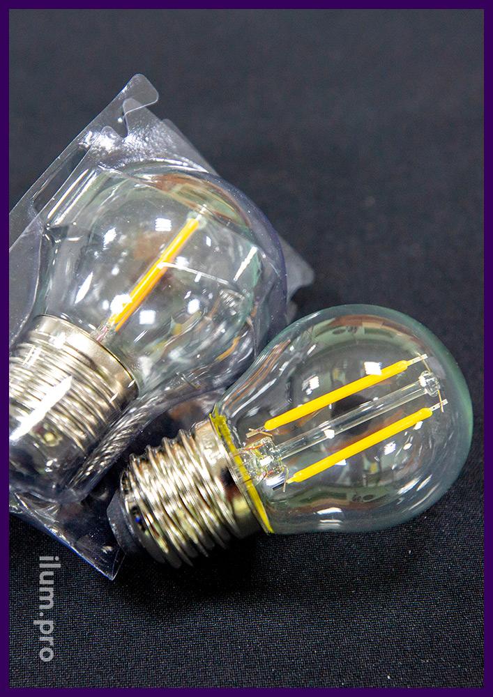 Прозрачная светодиодная лампа тёплых оттенков с филаментными модулями