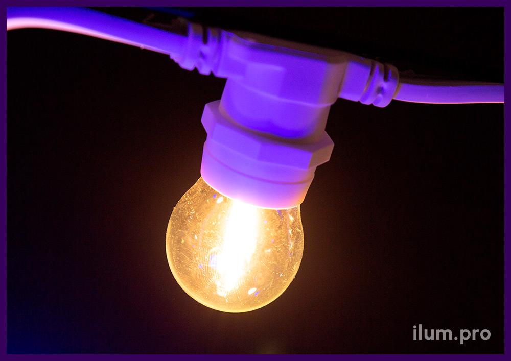 Уличная светодиодная лампочка белтлайт с филаментными модулями и прозрачной колбой