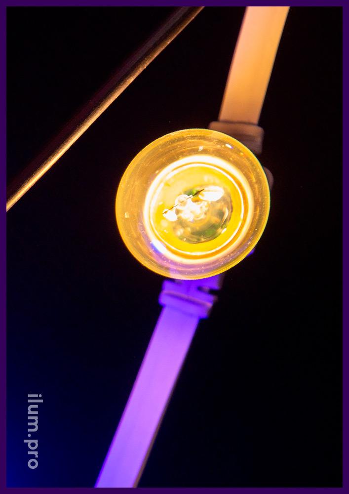 Лампа филаментная с защитой от влаги IP65 мощностью 2 Вт и тёплым оттенком