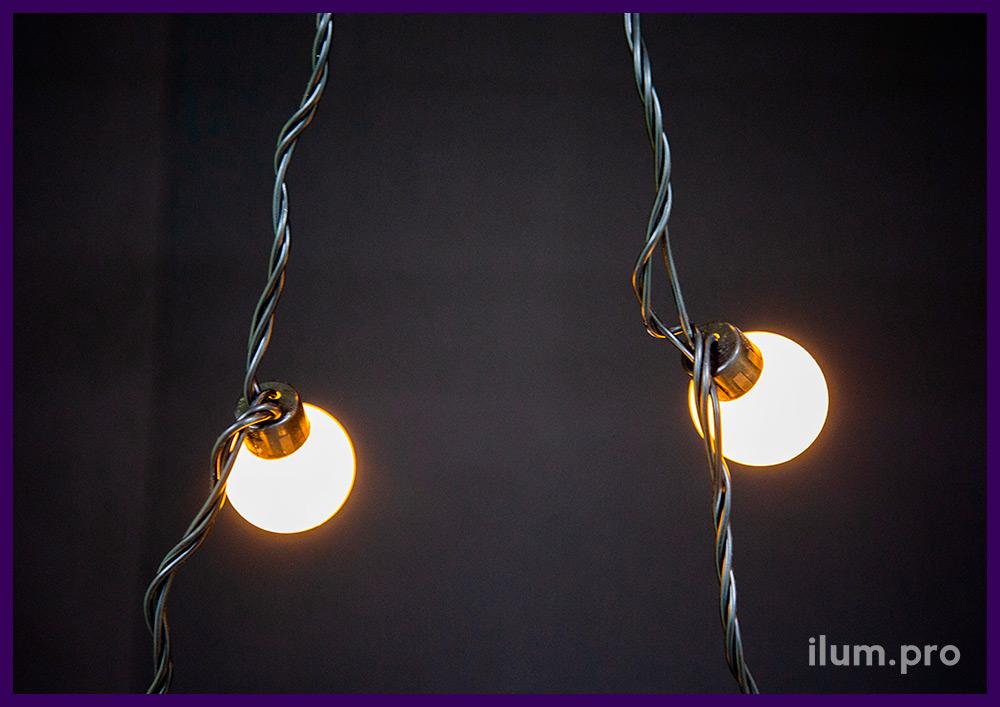 Тёпло-белые светодиодные мультишарики - гирлянда с чёрным проводом и защитой от осадков