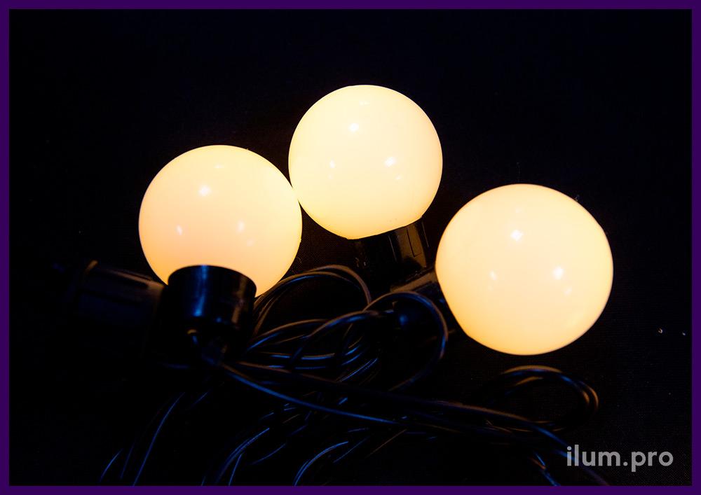 Мультишарики - светодиодная гирлянда с тёпло-белыми лампочками на чёрном проводе длиной 5 метров